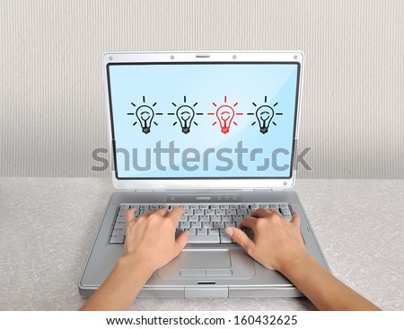 hands and laptop with lamps on the table