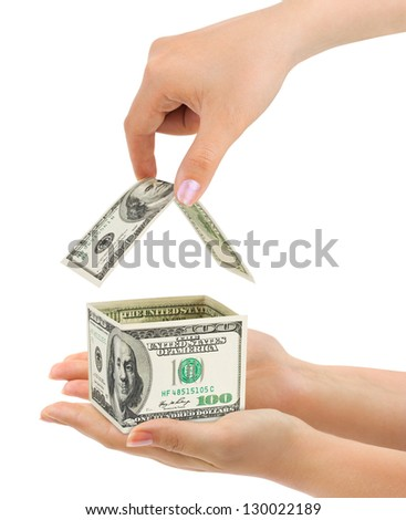 Hands and money house isolated on white background - stock photo