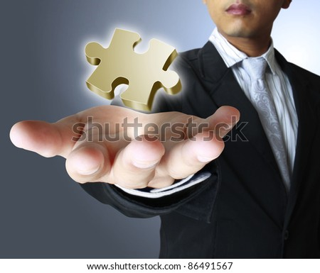 Hands and puzzle - stock photo