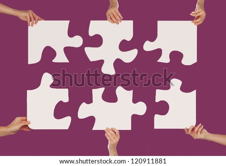 Hands and puzzle global concept - stock photo