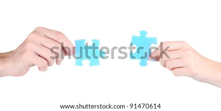 Hands and puzzle, isolated on white - stock photo