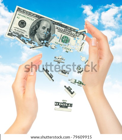 Hands and puzzle out of the money dollars. The concept of a dollar crisis - stock photo