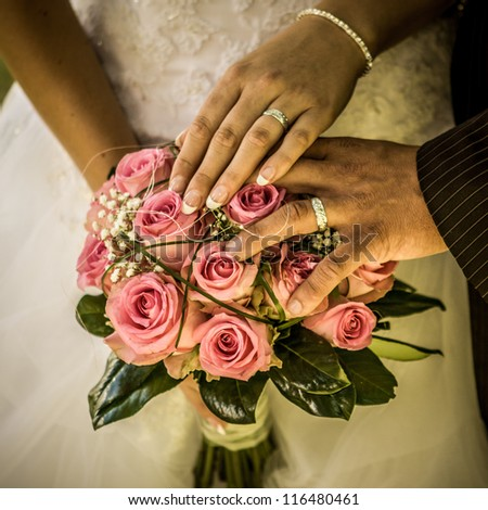Hands and rings on wedding - stock photo