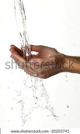 Hands and stream of water. On white background. - stock photo