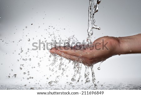 Hands and stream of water. On white background. High resolution.