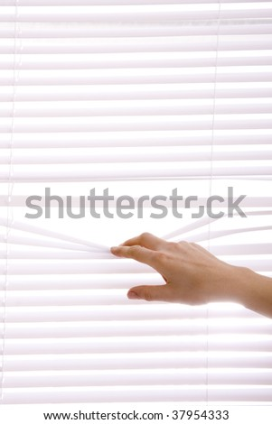 hands apart on the window blinds.. - stock photo