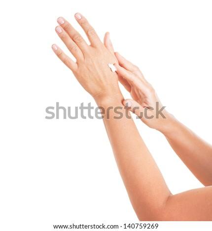 Hands applying moisturize cream. - stock photo