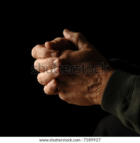 hands are folded in thought or tension