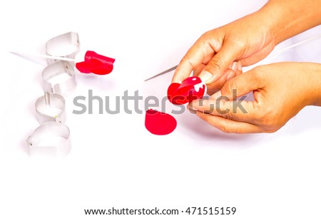 Hands are making artificial sculpture flower on white background.