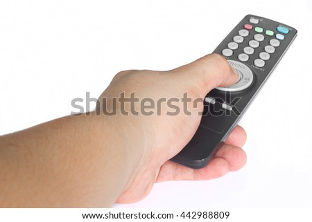 Hands are pressed Tv remote control on white background. - stock photo