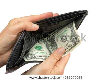 Hands are pulling out the last US One Dollar Bill from used empty black wallet. Isolated on the white background. - stock photo