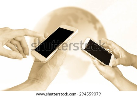 hands are using mobile phone with earth in color filter background - stock photo