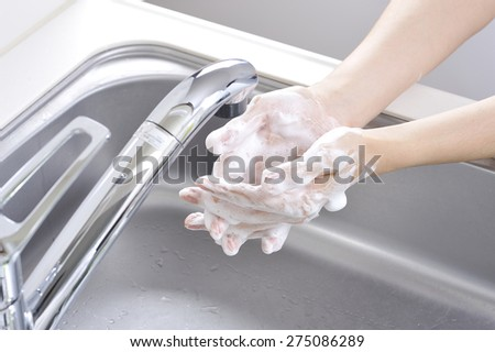 Hands are washed with soap - stock photo