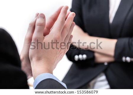 Hands arranged in a business gesture, closeup - stock photo