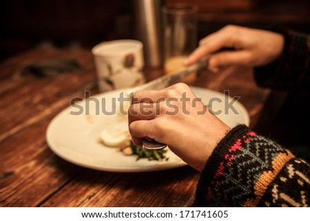 Hands at breakfast table