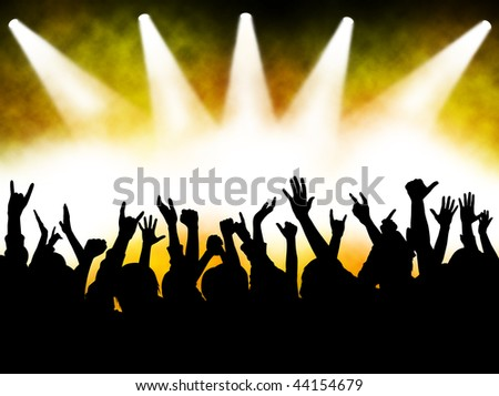 hands at the concert, silhouettes against stage lighting - stock photo