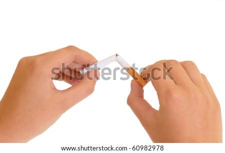 hands breaking a cigarette - stock photo