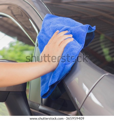 hands cars are wiped clean the car - stock photo