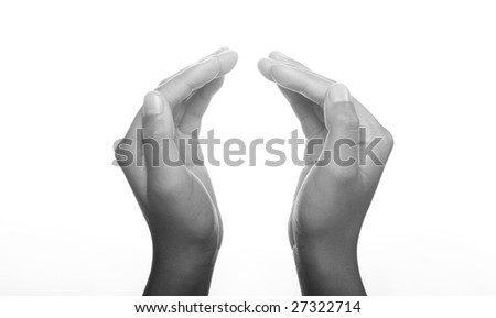 Hands clasped in religious prayer against white background - stock photo