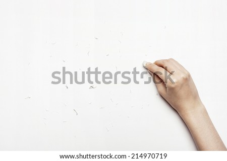 hands cleaning the paper with eraser isolated white. - stock photo