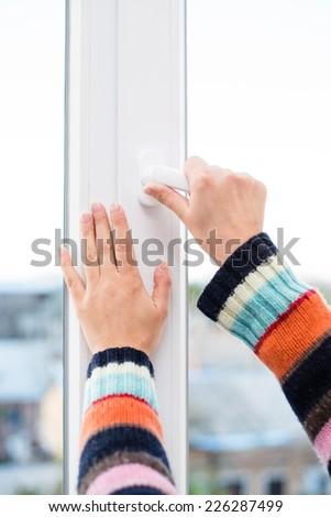 hands close open window - stock photo