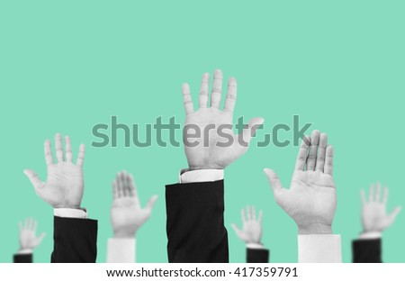 Hands colorless raising upward on pastel vintage tone background , abstract concept and ideas - stock photo