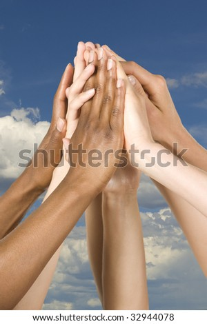 hands come together in unity - stock photo