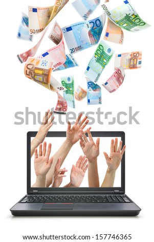 Hands comes from laptop screen reaching for Euro money flying in the air - stock photo