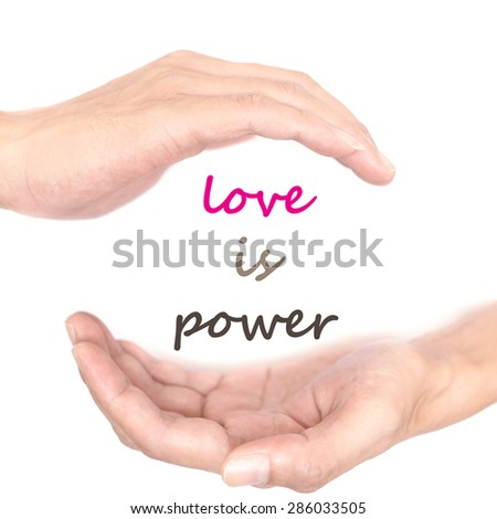Hands concept for love is power. Quote is between right and left hand - stock photo