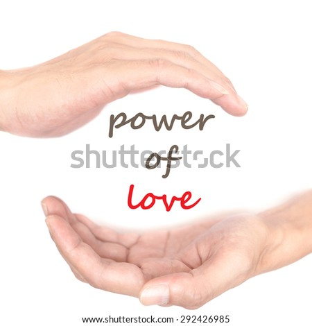 Hands concept for 'power of love'. Quote is between right and left hand - stock photo