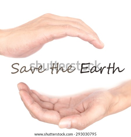 Hands concept for 'save the earth'. Quote is between right and left hand - stock photo
