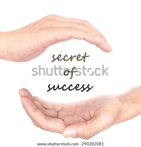 Hands concept for 'secret of success'. Quote is between right and left hand - stock photo
