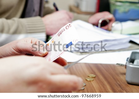 Hands counting cash - stock photo