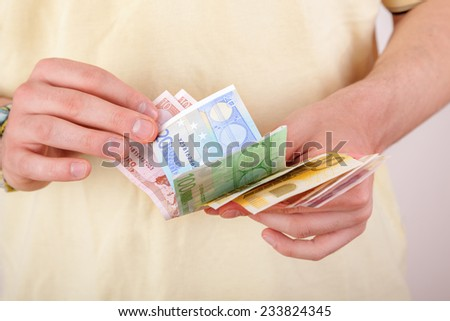 Hands counting money bills - stock photo