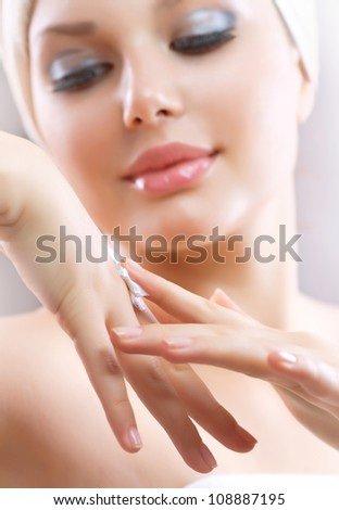 Hands Cream. Healthy Hands.Female applying moisturizer to her Hand after bath. Skincare concept - stock photo
