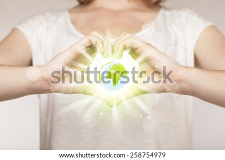 Hands creating a form with shining globe in the center - stock photo