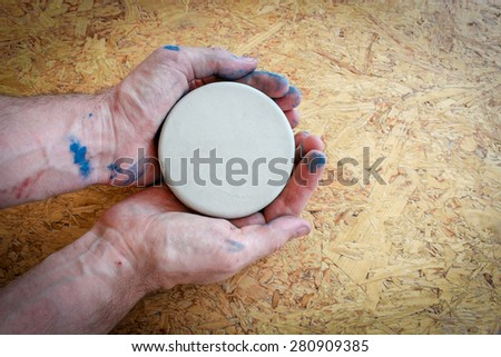 Hands Dirty With Blue Paint Holding And Showing An Empty Circle - stock photo