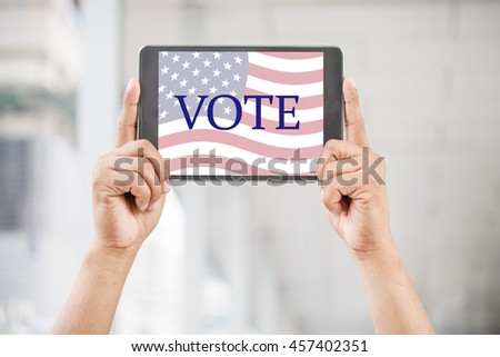 Hands display tablet the elections US president. - stock photo