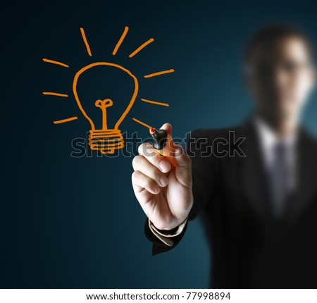 hands,drawing light bulb - stock photo
