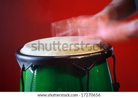 Hands drumming on bong drum. - stock photo
