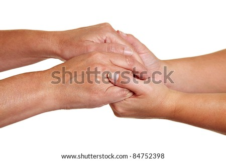Hands expressing symbolic sympathies while holding each other - stock photo