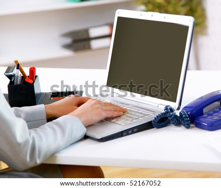 hands fast typing on laptop