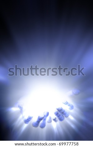 hands filled with light of good - stock photo