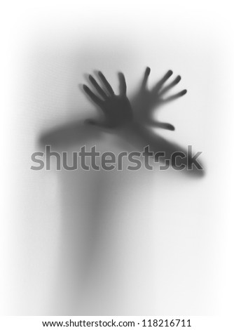 Hands, fingers behind a diffuse glass surface