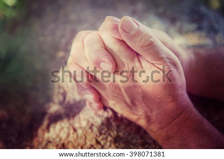 Hands folded in prayer - stock photo