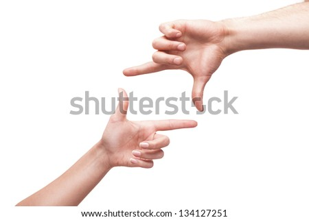 Hands forming a frame in blank for insert text or design isolated on white background - stock photo