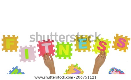 """Hands forming word """"Fitness"""" with jigsaw puzzle pieces isolated - stock photo"""
