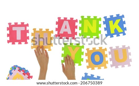 """Hands forming words """"Thank you"""" with jigsaw puzzle pieces isolated - stock photo"""