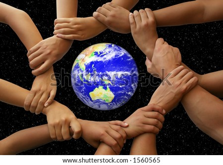 Hands framing the earth in a global team theme - stock photo