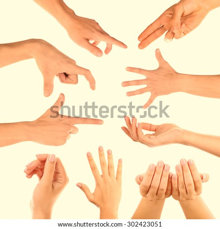 Hands gestures on light background - stock photo